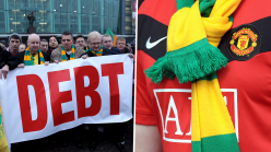 Why do Man Utd fans wear yellow & green scarves?